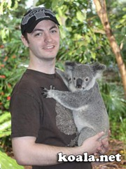 Jason Rundell and his koala, Lone Pine Koala Sanctuary